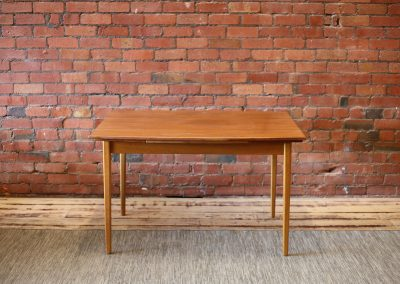 Modernist teak dining table