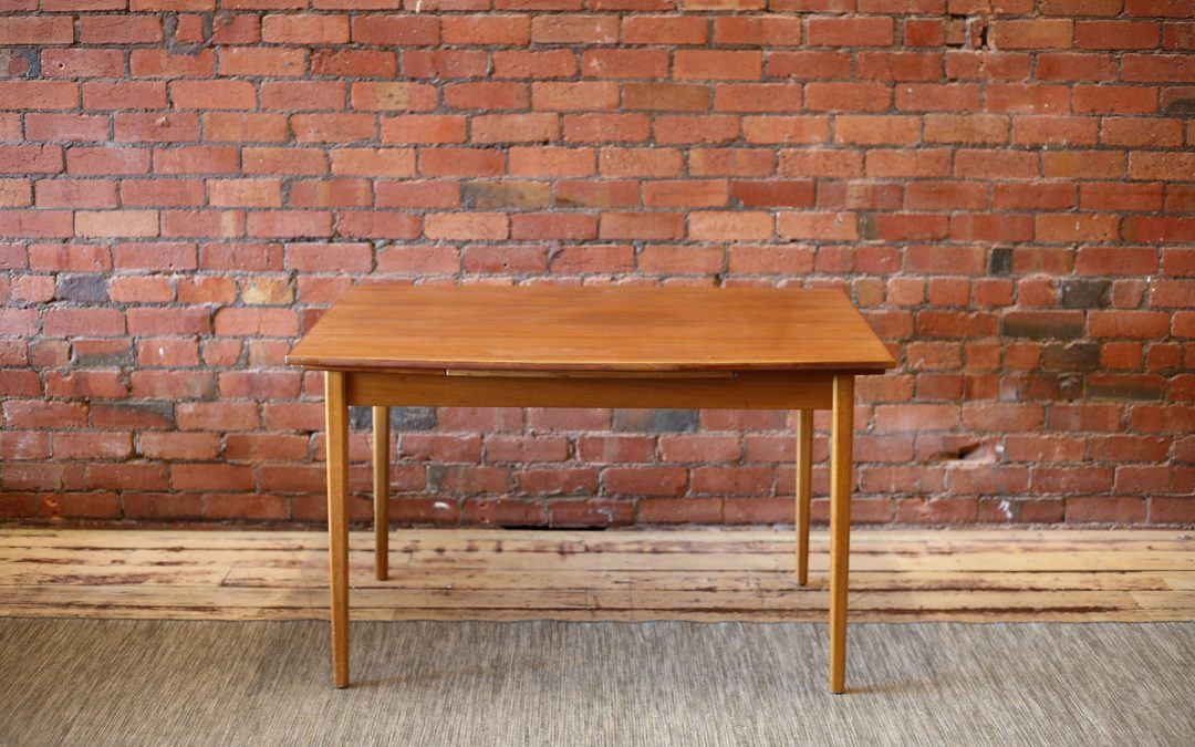 Modernist teak dining table
